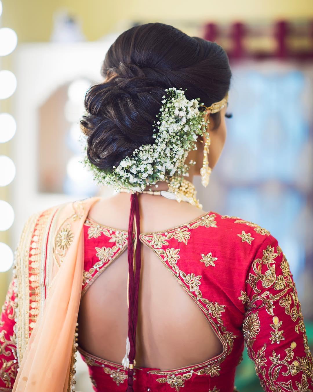Floral Bun Hairstyles for Brides Mini flowers bun: