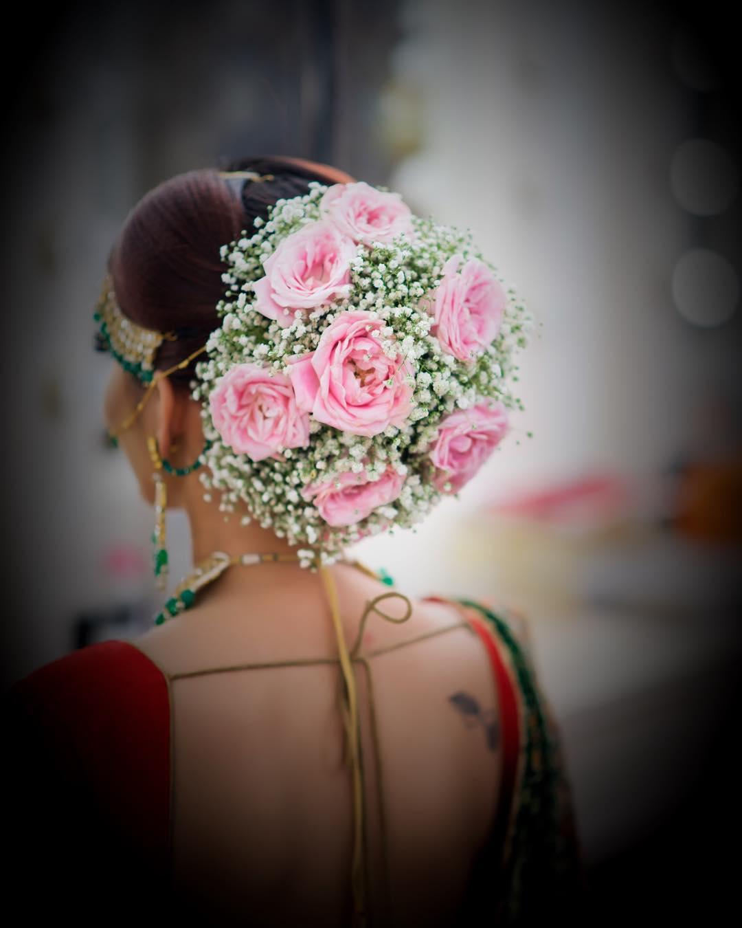 Floral Bun Hairstyles for Brides Pink rose floral bun: Top 15 Floral Bun Hairstyles for Brides this Wedding Season