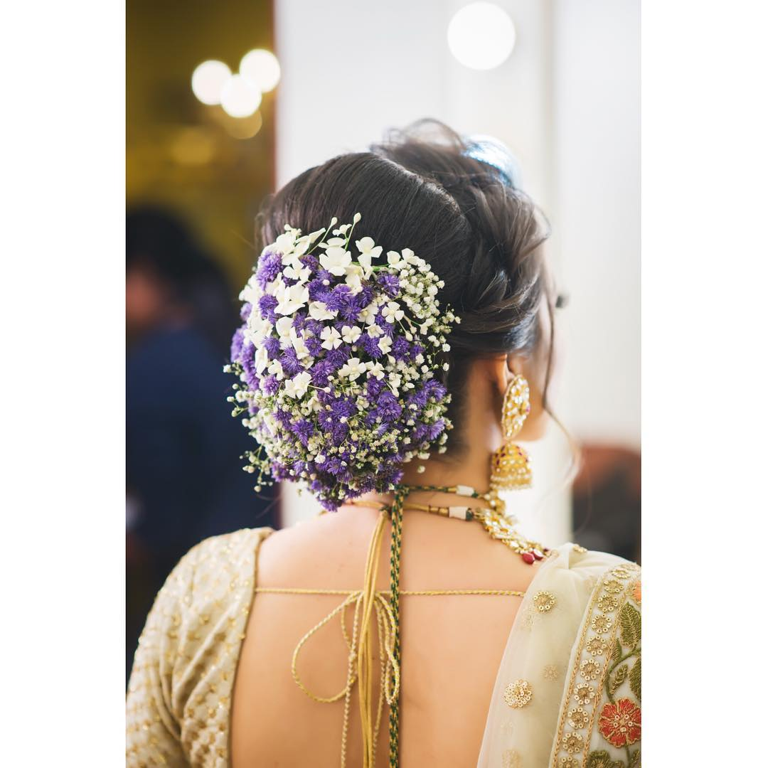Floral Bun Hairstyles for Brides Purple floral bun: Top 15 Floral Bun Hairstyles for Brides this Wedding Season