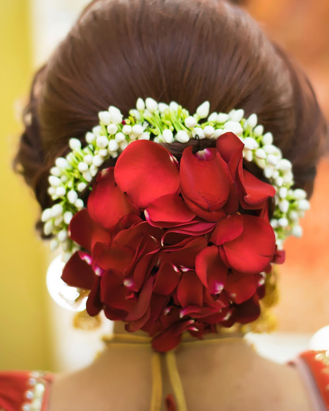 Top 15 Floral Bun Hairstyles for Brides this Wedding Season