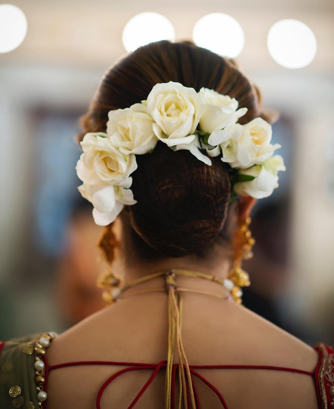 Floral Bun Hairstyles for Brides White rose floral bun: Top 15 Floral Bun Hairstyles for Brides this Wedding Season